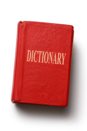 Old dictionary on white background
