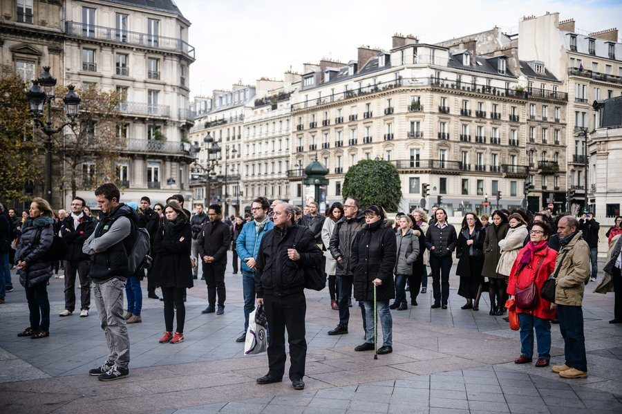 People gather to hold a minute of silence in front of the Paris city Hall, France, on Monday. Photo Credit: Christophe Petit Tesson /EPA /LANDOV