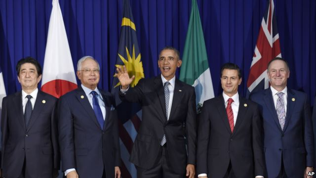FILE - President Barack Obama (c) and other leaders of the Trans-Pacific Partnership countries pose for a photo in Manila, Philippines, Nov. 18, 2015 / Photo Source: VoA