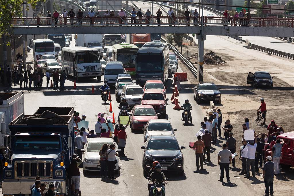 People block a highway leaving Mexico City as a protest to an increase in gas prices on Jan. 4. Photo Source: Brett Gundlock / Getty Images