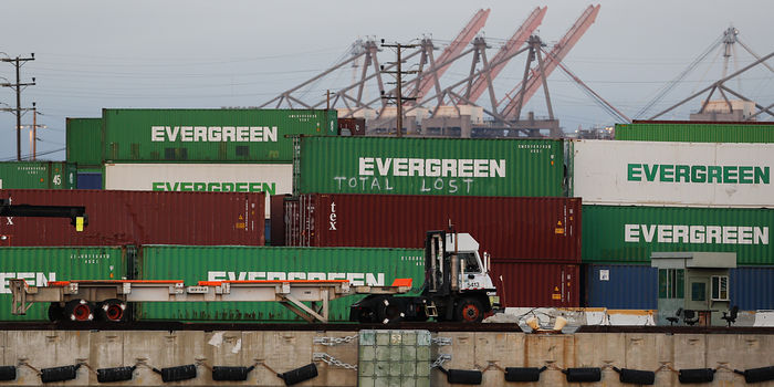 A truck drives past Evergreen shipping containers at the Port of Los Angeles.