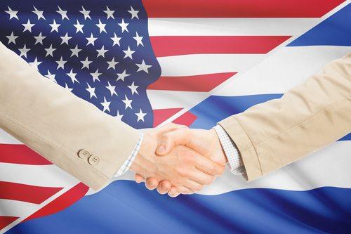 Businessmen handshake - United States and Cuba