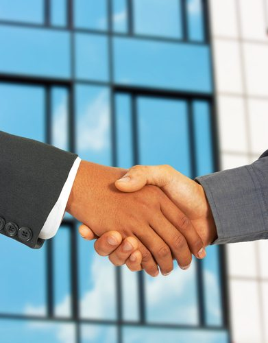 Businessmen Greet Each Other By Shaking Hands