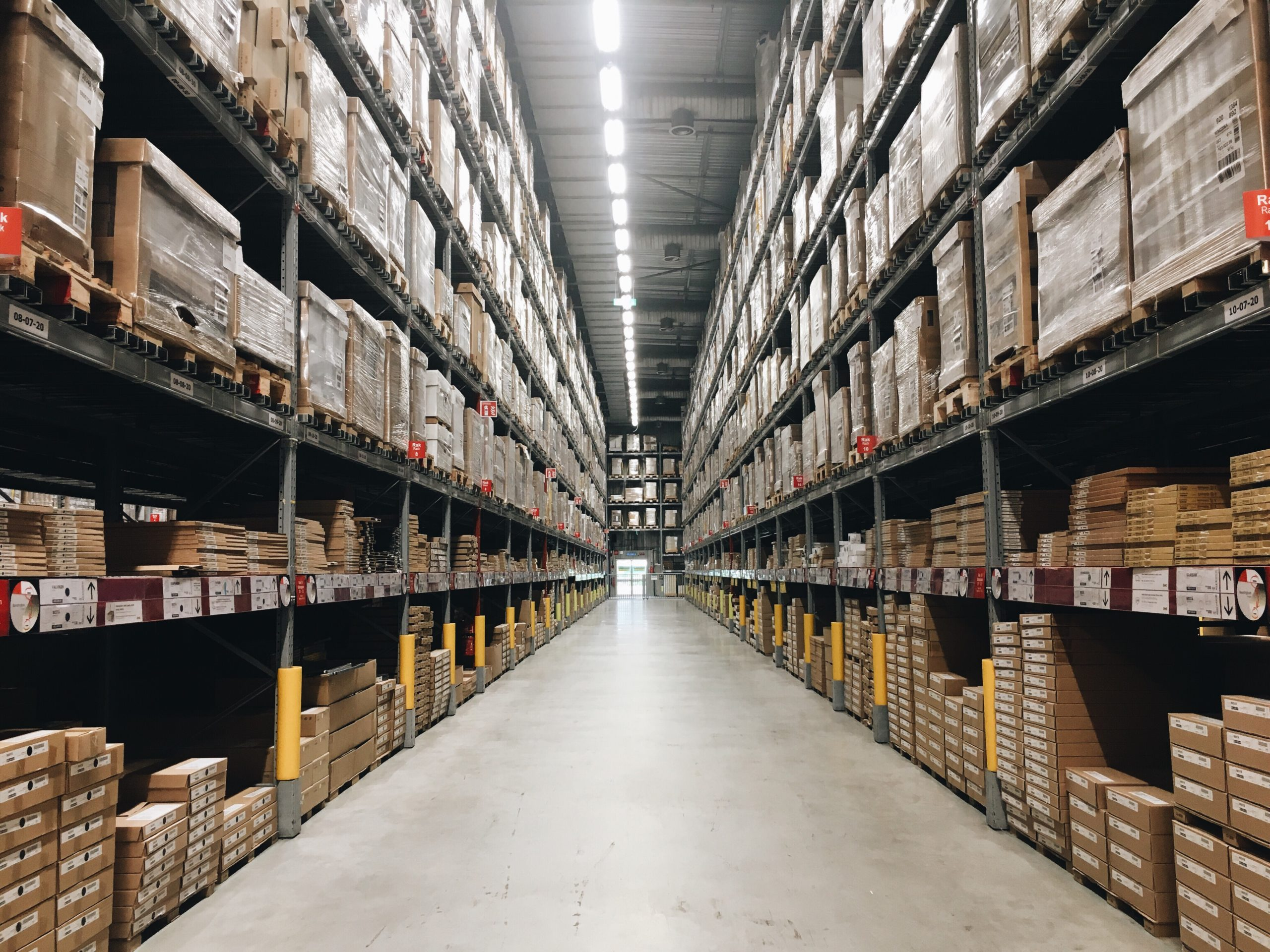 floor to ceiling shelving in warehouse.